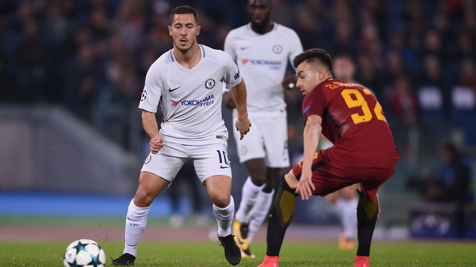 Chelsea midfielder Eden Hazard (L) fights for the ball with Roma striker Stephan El Shaarawy during a UEFA Champions League match at the Olympic Stadium in Rome.