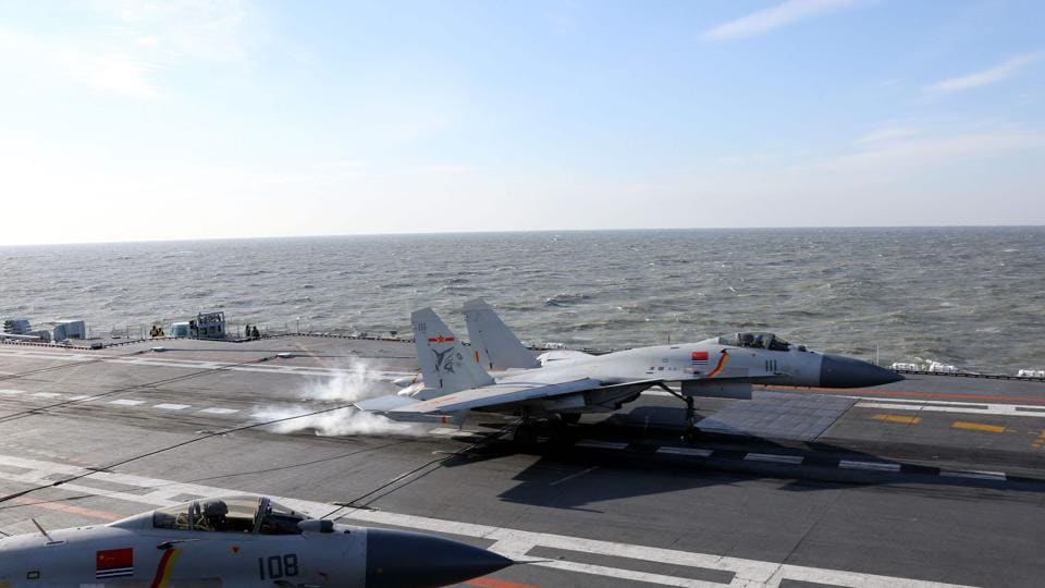 A Chinese J-15 fighter jet on the deck of the Liaoning aircraft carrier during military drills in the Bohai Sea, off China's northeast coast.