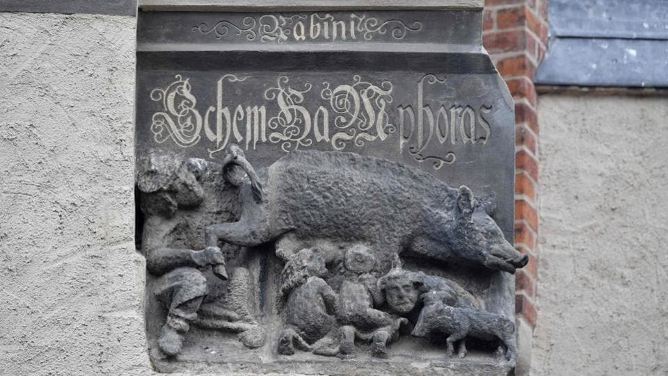 A medieval anti-Semitic carving depicting Jews suckling the teats of a sow as a rabbi looks intently is pictured at the Stadtkirche, Martin Luther's home church in Wittenberg. The theologian's name has also been associated with one of Germany's darkest periods --his attacks on Judaism in his writings were used as a reference for Nazi ideology. Merkel has said it was essential that Luther's anti-Semitism never be scrubbed from his theological legacy. (John Macdougall / AFP)