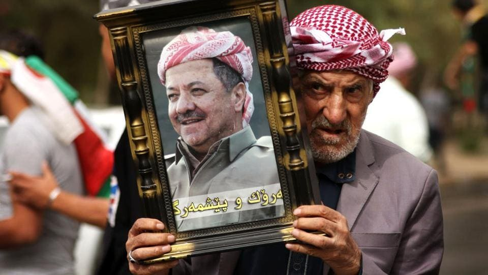 An Iraqi Kurd holds a picture of Kurdish Regional Government (KRG) leader Massud Barzani, during a protest in his support in Arbil, the capital of autonomous Iraqi Kurdistan. Masoud Barzani told a closed-door session of the regional parliament on October 29, 2017 that he was stepping down amid the fallout of the controversial Kurdish independence referendum and Iraqi military intervention in Kurdish-held territories. (Safin Hamed / AFP)