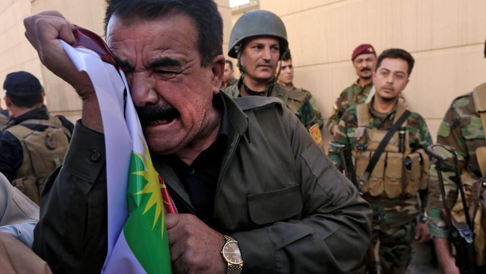 Iraqi Kurds take part in a demonstration outside the US consulate in Erbil to protest against the escalating crisis with Baghdad. Washington, which has worked closely with both Kurdish and Iraqi forces in the battle against the Islamic State group, had urged Barzani not to go ahead with the vote. (Safin Hamed / AFP)