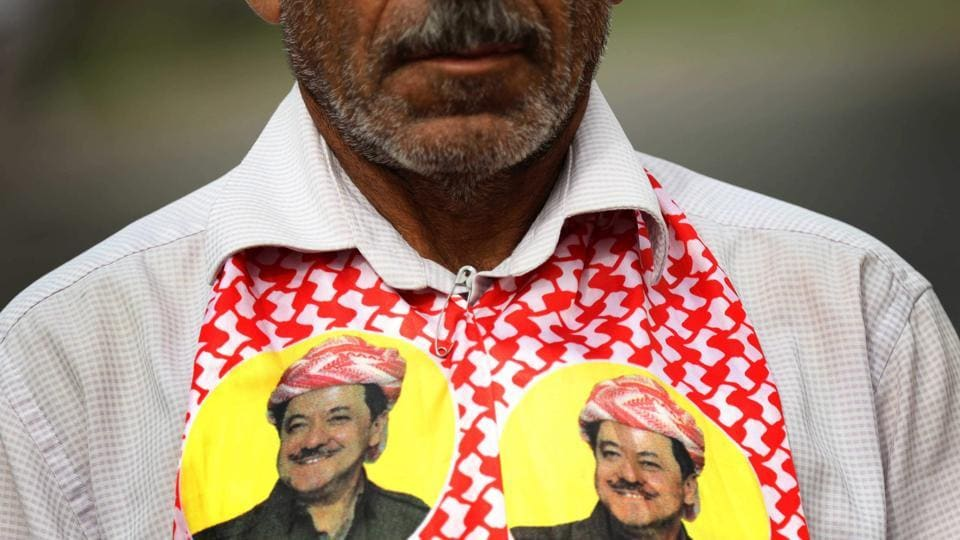 An Iraqi Kurd wears a scarf bearing a portrait of the Iraqi Kurdish leader Massud Barzani, during a protest in his support, in Erbil. The loss of the oilfields, which provided income that would have been critical to an independent Kurdish state, sparked recriminations among Kurds and ratcheted up the pressure on Barzani to quit. (Safin Hamed / AFP)
