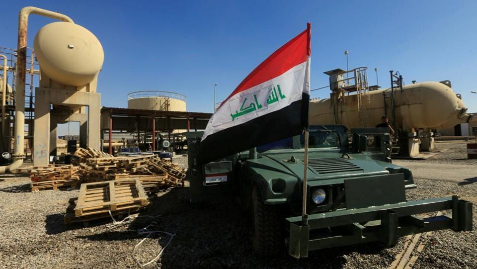 An Iraqi flag is seen on a military vehicle at an oil field in Kirkuk. Control of the border areas is of crucial for the landlocked Kurdish region. An oil pipeline runs from northern Iraq into Turkey, carrying crude exports which were the principal source of funds for the Kurds. Since mid-October, Iraqi forces have reclaimed the oil-rich province of Kirkuk dealing a severe blow to Barzani's ambitions of Kurdish statehood. (Alaa Al-Marjani / REUTERS)