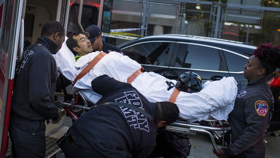 Emergency personnel carry a man into an ambulance after the attack near the World Trade Center memorial. New York Governor Andrew Cuomo called it a 'lone wolf' attack and said there was no evidence to suggest it was part of a wider plot. The city's police commissioner, James O'Neill, said a statement the driver made as he got out of the truck and the method of attack led police to conclude it was a terrorist act. (Andres Kudacki / AP)