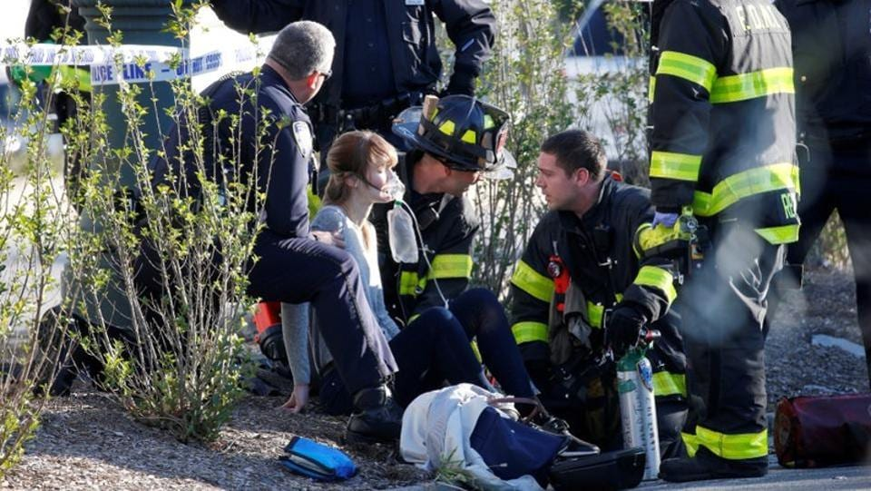 A woman is aided by first responders after sustaining injury on a bike path in lower Manhattan. Five of the people killed were Argentine tourists who travelled to New York for a 30-year high school reunion, said a senior official in Santa Fe province, where they were from. Belgian officials said one of those killed and three of the injured were from Belgium. (Brendan McDermid / REUTERS)