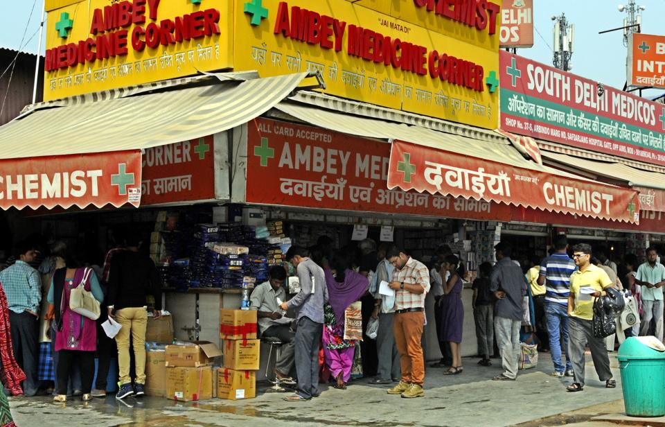 People outside a chemist shop in New Delhi.