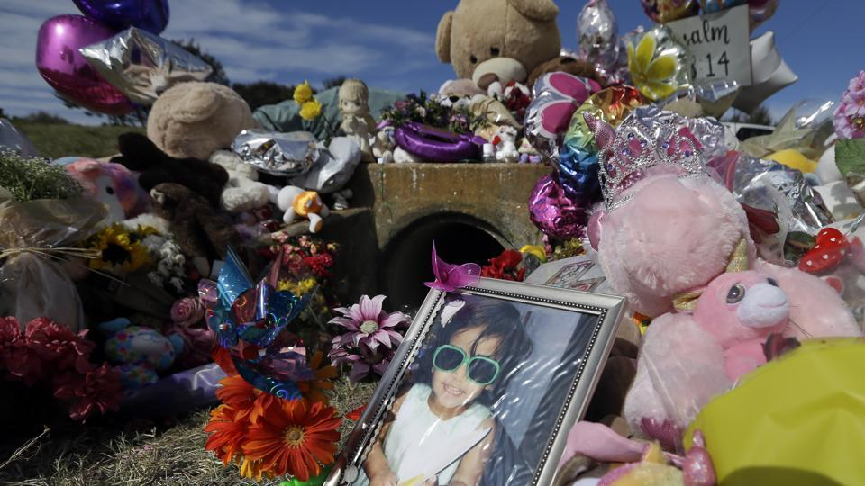 A photograph of 3-year-old Sherin Mathews sits by a makeshift memorial on Saturday in Richardson, Texas.