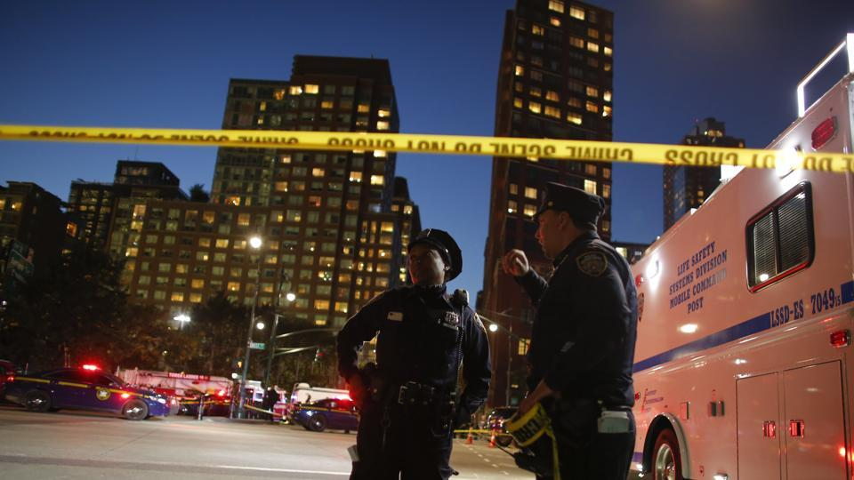 Emergency personal respond after a man driving a rental truck struck and killed eight people on a jogging and bike path in Lower Manhattan on Tuesday night.