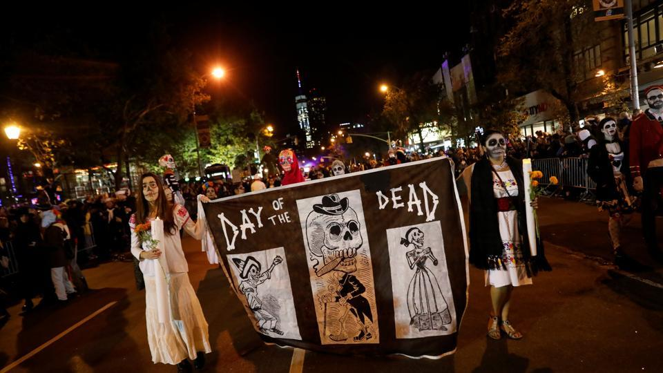 People participate in the New York City Halloween parade in US on Tuesday night.