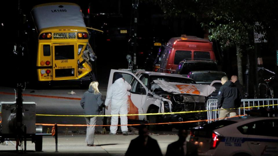 Police investigate a pickup truck used in an attack on the West Side Highway in Manhattan, New York, on Wednesday.
