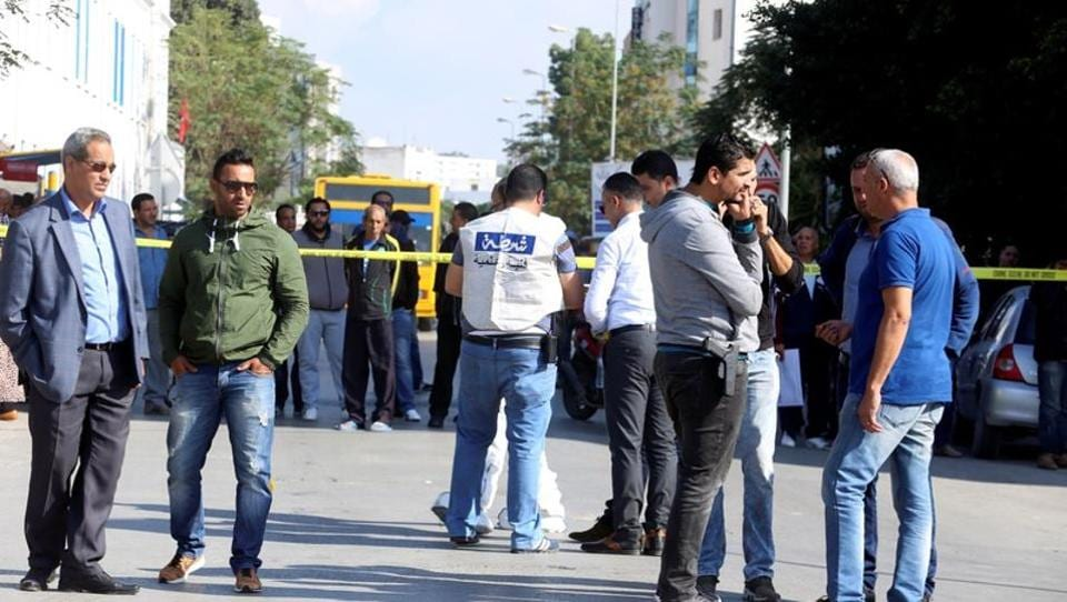 Police officers are seen where a suspected Islamist militant was arrested after wounding two policemen in a knife attack near the parliament building in Tunis.