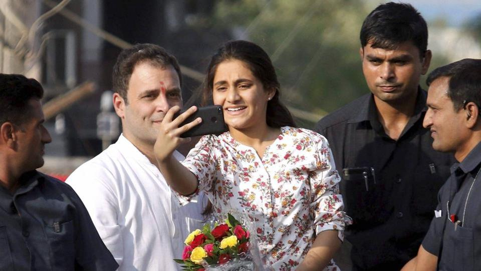 A young girl takes selfie with Congress vice president Rahul Gandhi during his road show in Bharuch on Wednesday.