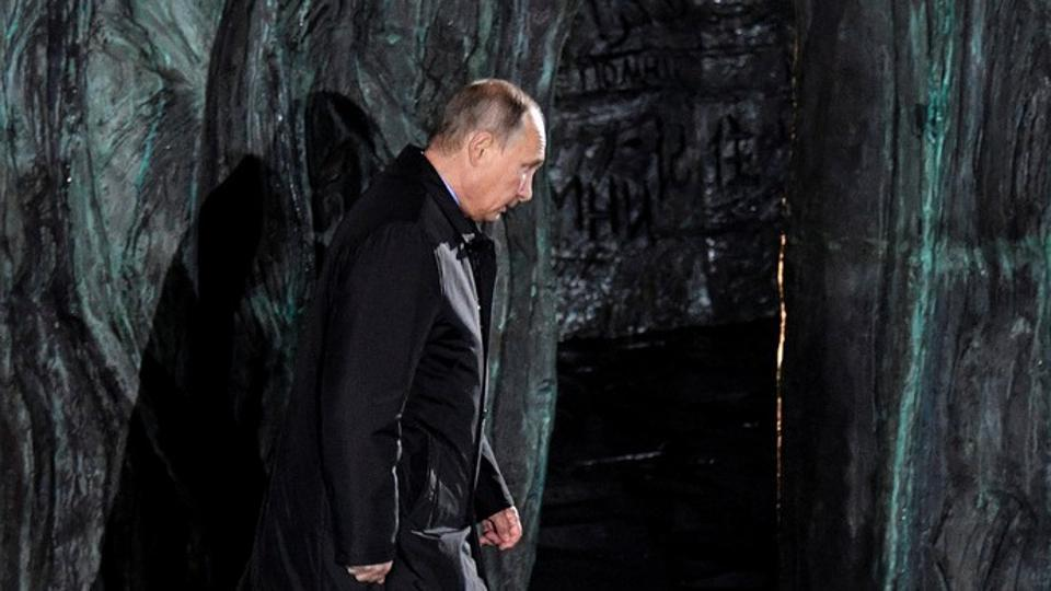 Russian President Vladimir Putin attends a ceremony unveiling the country's first national memorial to victims of Soviet-era political repressions called