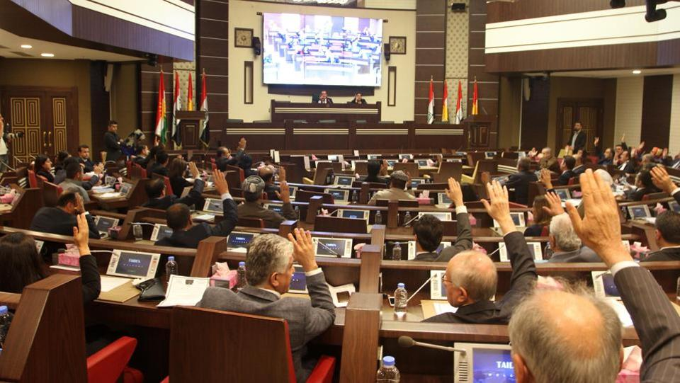 A general view of Kurdish MPs sitting during a session of Kurdistan's regional parliament in Erbil. Massud Barzani accused his political rivals of 'high treason' for giving up the contested oil-rich city of Kirkuk to central government troops. The KRG and the central government held talks from Friday till Sunday last week to resolve their conflict. (KURDISH PRIME MINISTER'S OFFICE / HO / AFP )