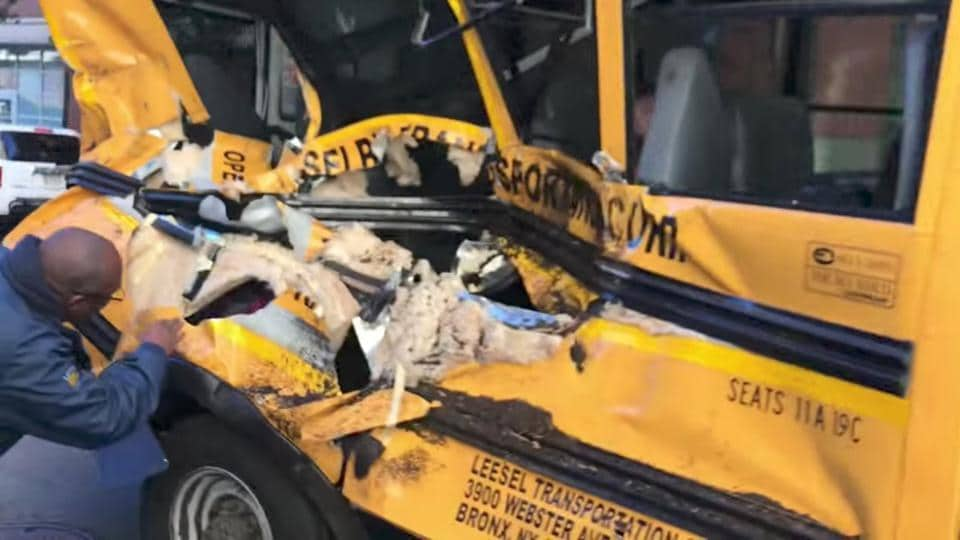 A damaged school bus is seen at the scene of a pickup truck attack in Manhattan. The driver barreled along the bike path in a rented Home Depot truck for the equivalent of about 14 blocks, or 1.2 km, before slamming into a small yellow school bus. The mayhem and police gunfire set off panic in the neighborhood. (Sebastian Sobczak / REUTERS)