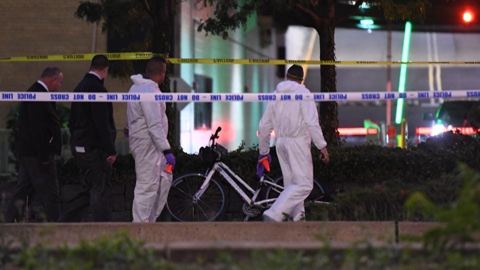 Authorities inspect the scene following a shooting incident in New York on Tuesday.