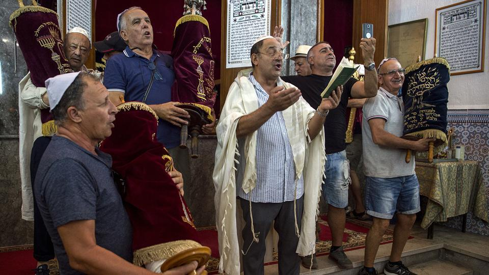 Moroccan Jews and Israeli Jewish tourists participate in a religious ceremony to observe the holiday of Sukkot.