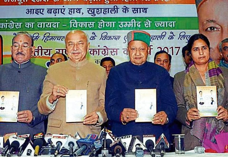 HP chief minister Virbhadra Singh (second from right) and Congress state in-charge Sushil Kumar Shinde (second from left) at the manifesto launch in Shimla on Wednesday.