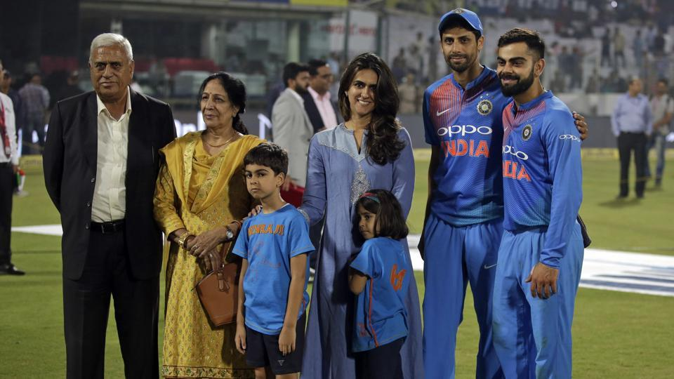 Virat Kohli poses along with Ashish Nehra's family after the end of the game at The Kotla. (AP)