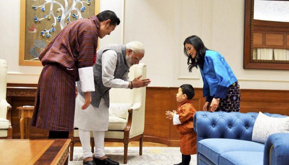 Bhutanese King Jigme Khesar Namgyel Wangchuck and Queen Jetsun Pema look on as Prime Minister Narendra Modi interacts with their son Prince Jigme Namgyel Wangchuck during a meeting in New Delhi on Wednesday.