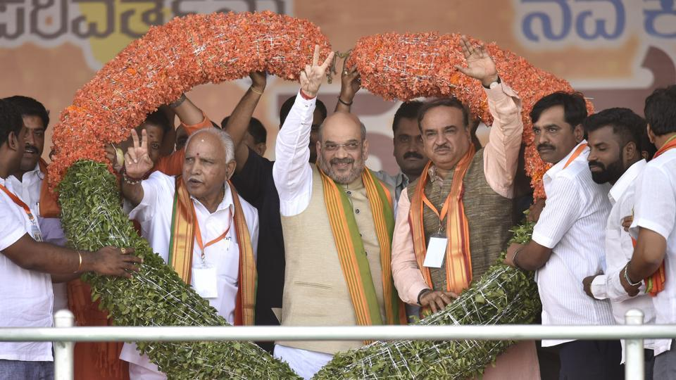 BJP national president Amit Shah(C), BJP Karnataka president and Chief Minister candidate Yeddurappa(L) and Union Minister Ananth Kumar during Nava Karnataka Nirmana Parivarthana Yatra in Bengaluru.