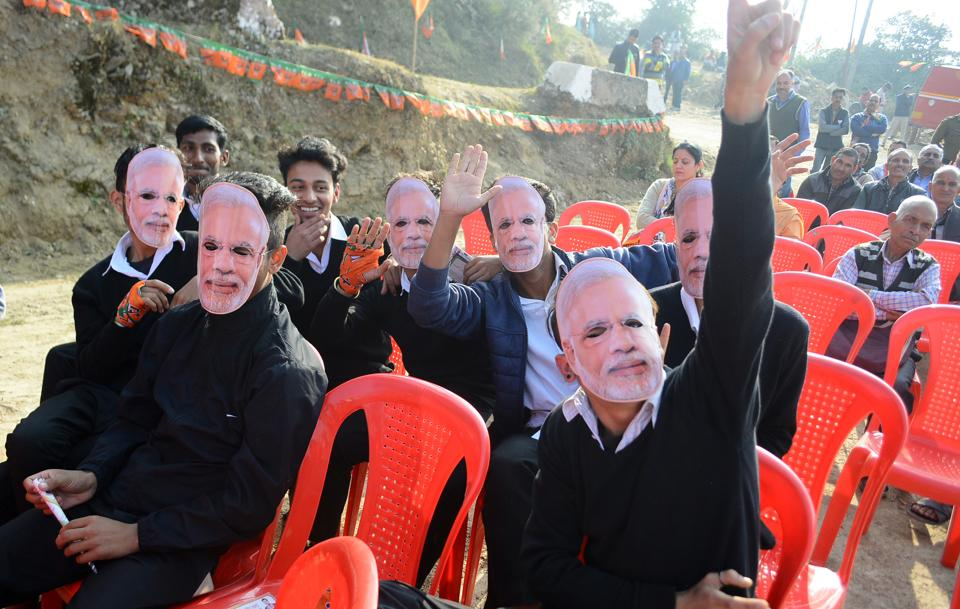 Youngsters wearing masks of Prime Minister Narendra Modi during the election rally of BJP candidate Pramode Sharma at Shoghi in Shimla. (Deepak Sansta /ht)