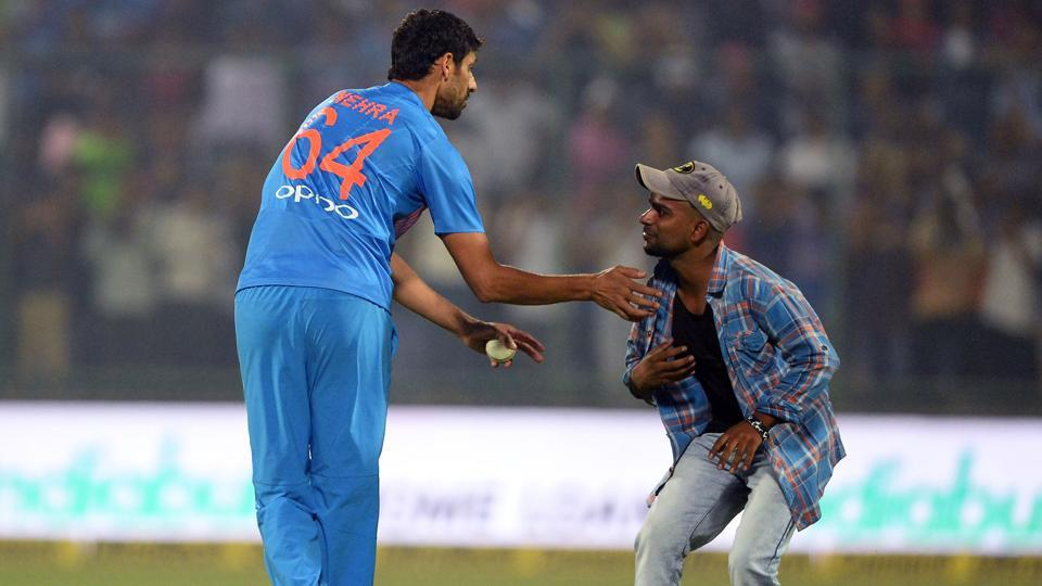 A fan sought the blessing of Indian cricket team bowler Ashish Nehra during the first T20 cricket match between New Zealand and India at Feroz Shah Kotla Cricket Stadium in New Delhi. (AFP)