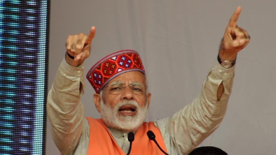 Prime Minister Narendra Modi addressing an election rally at Rehan in the Fatepur assembly segment of Kangra district on November 2. The Prime Minister attacked the Congress for promising 'zero tolerance' on corruption when its own chief minister was facing allegations of graft and said the state's ruling party had become a 'laughing club'. (Shyam Sharma /ht)
