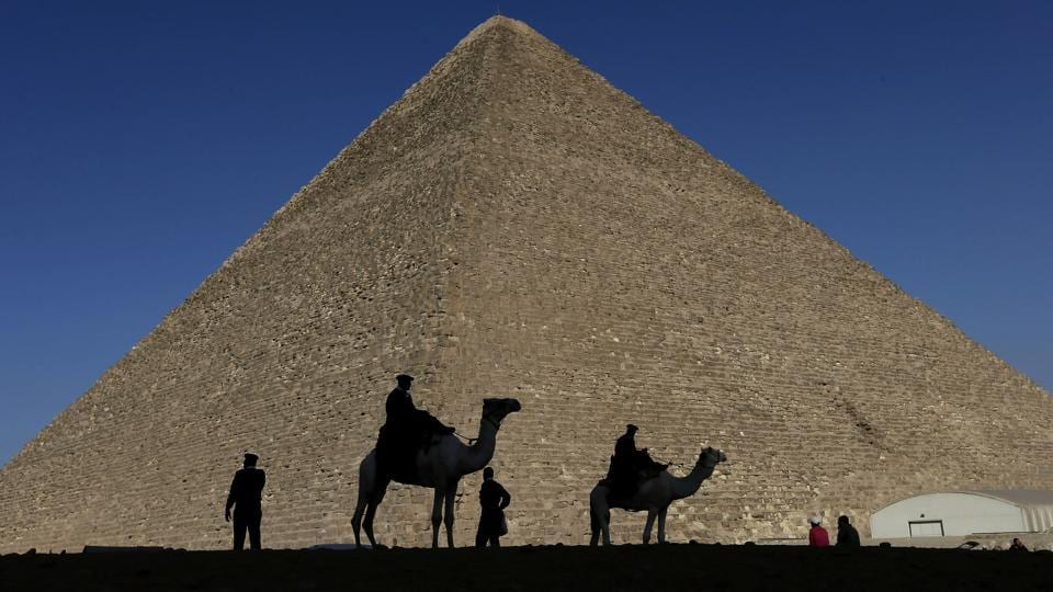 In this Dec. 12, 2012 file photo, policemen are silhouetted against the Great Pyramid in Giza, Egypt.