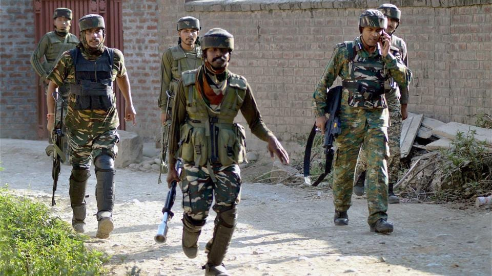 Soldiers take position outside a house where militants were hiding during an encounter --- in which top three Hizbul Mujahideen Commanders and two Army soldiers were killed --- at Awneera in Shopian district of south Kashmir.