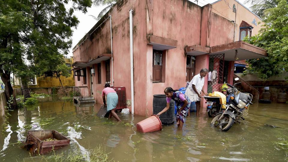 A view of a flooded locality following heavy rains due to the onset of monsoon in Chennai. Clogged sewer lines, coupled with the heavy rain, forces water inside several houses in south Chennai. (R Senthil Kumar / PTI)