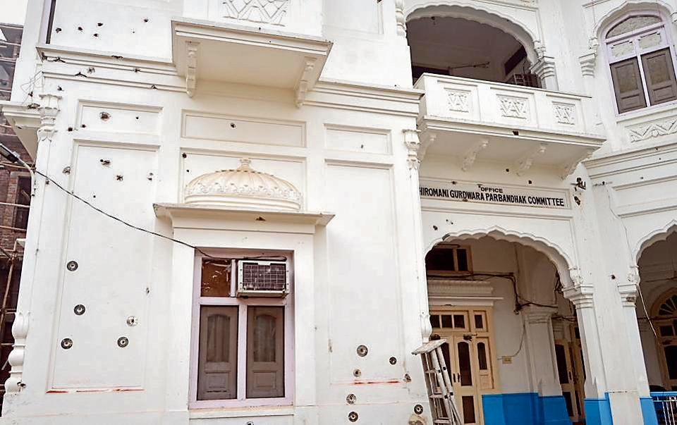 Bullet marks on the facade of the Teja Singh Samundari Hall building preserved with metallic circles after the renovation.