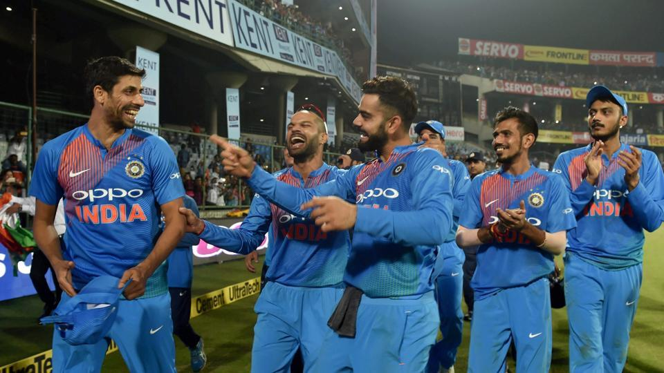 Virat Kohli and Shikhar Dhawan have fun with Ashish Nehra after the end of the game against New Zealand at the Kotla. (PTI)