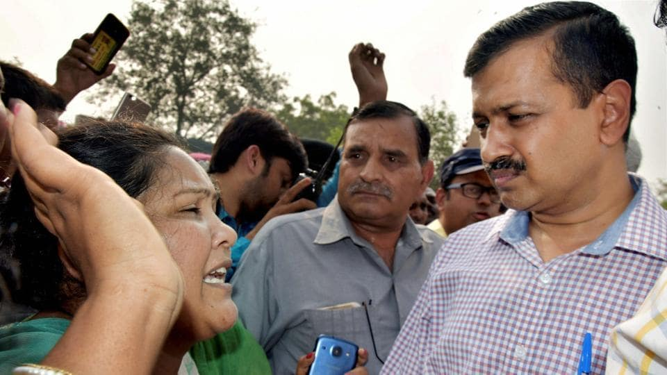 Delhi chief minister Arvind Kejriwal interacts with the residents of Kathputli Colony on November 2.