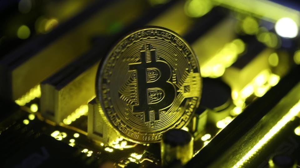 A copy of bitcoin standing on PC motherboard is seen in this illustration, October 26, 2017.