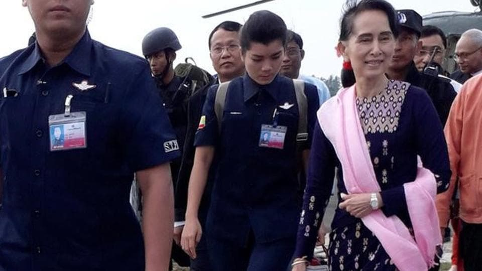 Myanmar's leader Aung San Suu Kyi arrives at Sittwe airport in the state of Rakhine on Thursday.
