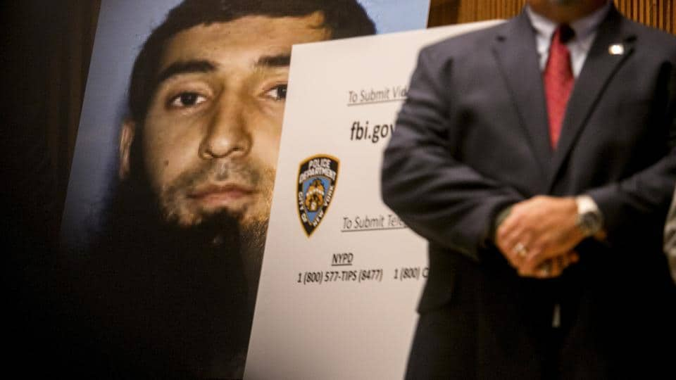 A photo of Sayfullo Saipov is displayed at a news conference where New York officials briefed reporters on the investigation against Sayfullo Saipov, who killed eight people and injured 12 with his pic-up truck.