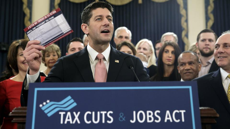 Speaker of the House Paul Ryan, R-Wis., with House Majority Whip Steve Scalise, R-La., far right, holds a proposed