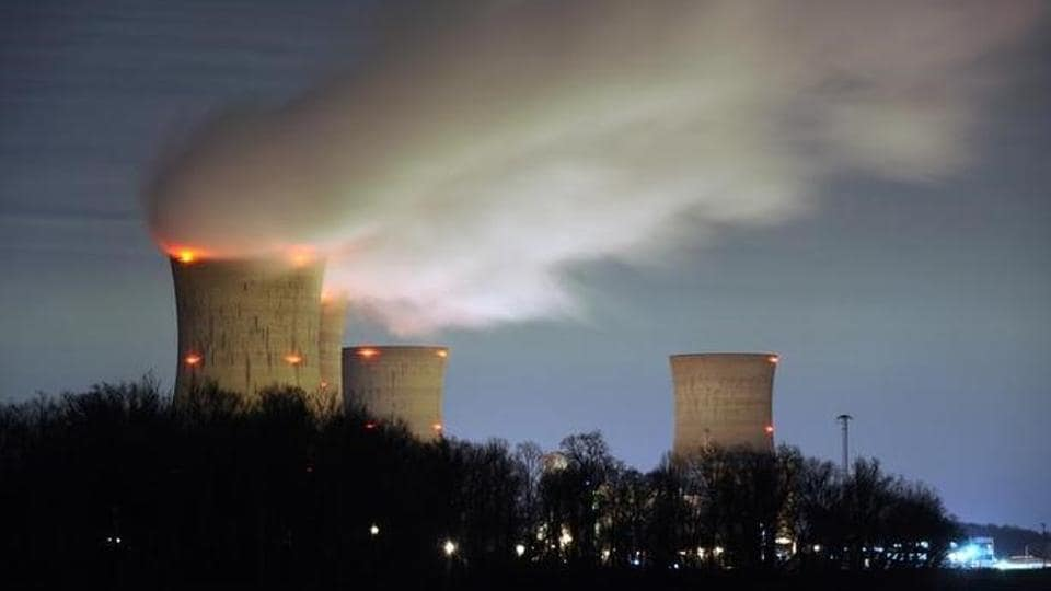 The Three Mile Island nuclear power plant, where the U.S. suffered its most serious nuclear accident in 1979, is seen across the Susquehanna River in Middletown, Pennsylvania in this night view taken March 15, 2011. REUTERS/Jonathan Ernst/Files