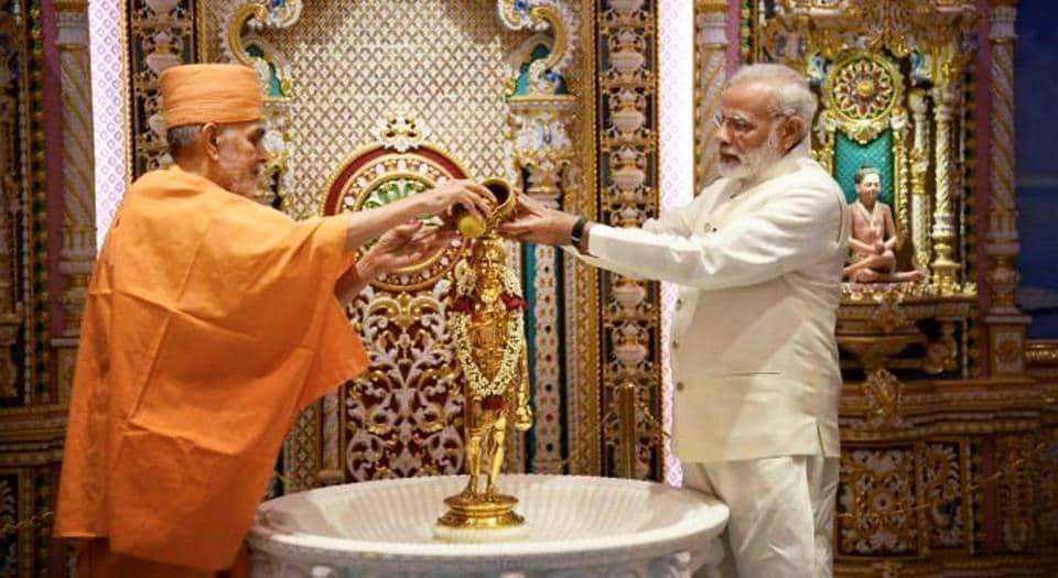 Prime Minister Narendra Modi along with Mahant Swami Maharaj offer puja at Akshardham on the occasion of the temple's silver jubilee celebration in Gandhinagar on November 2.