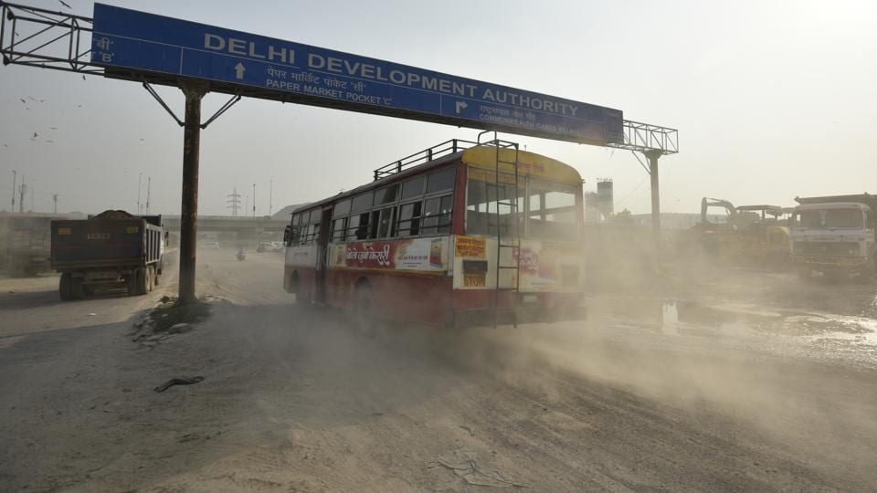 A wave of dust emerges from a road construction site at NH-24. Experts say vehicular emissions and stubble burning by farmers in neighbouring states are primary reasons for the capital's poor air. Dust particles and construction activity, also contribute to the problem. (Ravi Choudhary/HT PHOTO)