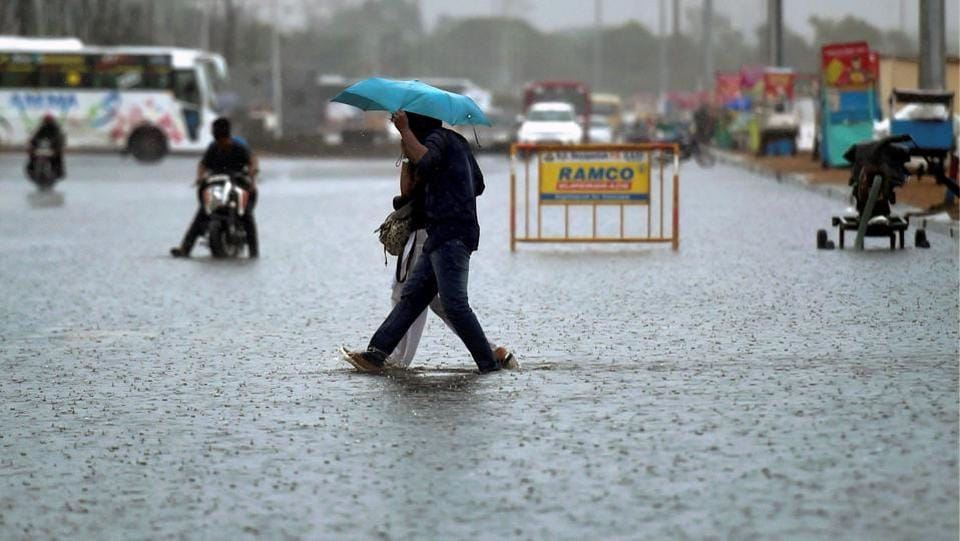 A couple crosses the water logged service road near the Marina beach during downpour in Chennai. Water logging in previous days has been reported in Anna Nagar, Vadapalani, West Mambalam, T Nagar, Ashok Nagar junction, Nandanam, Mogappair, Ambattur, Perambur, Mudichur, and Perangalathur. These areas faced severe problem in 2015 when Chennai was flooded for three days. (PTI)