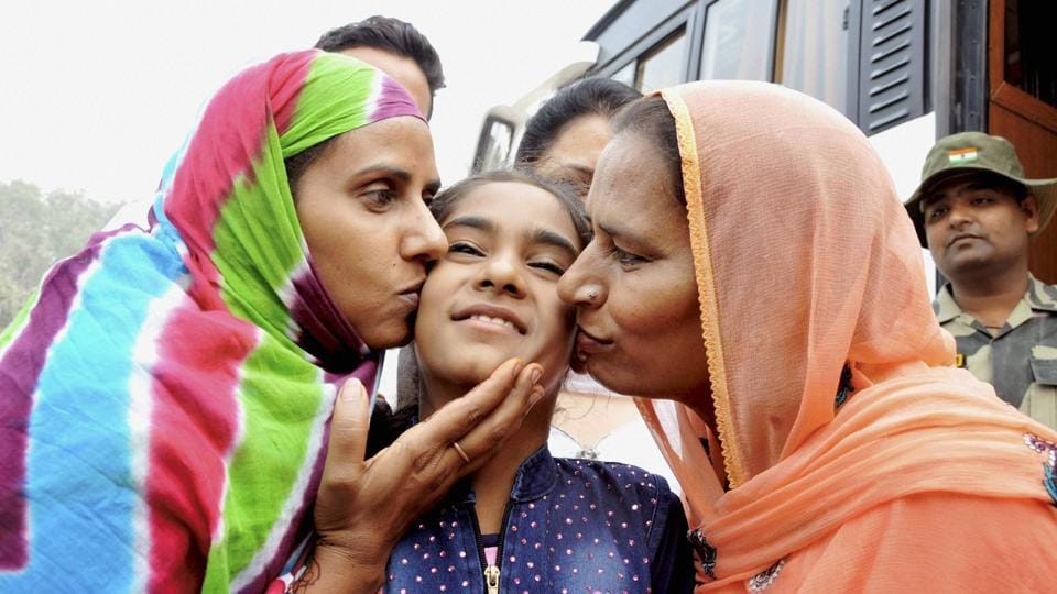 Pakistani sisters Mumtaz and Fatima along with 10-year-old daughter Hina cross over to Pakistan side at Indo-Pak border at Attari on Thursday.