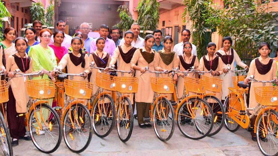 Girl students get bicycles from MLA Surendra Pareek at government girls' school in Jaipur.