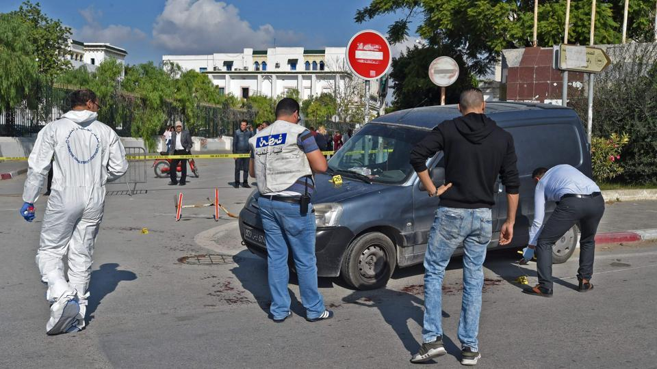 Tunisian forensic police check the scene of an attack on two traffic policemen in Tunis on November 1, 2017.
