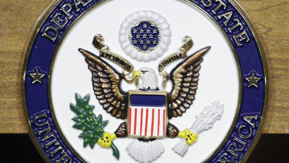 United States Department of State seal on a podium at the State Department in Washington.