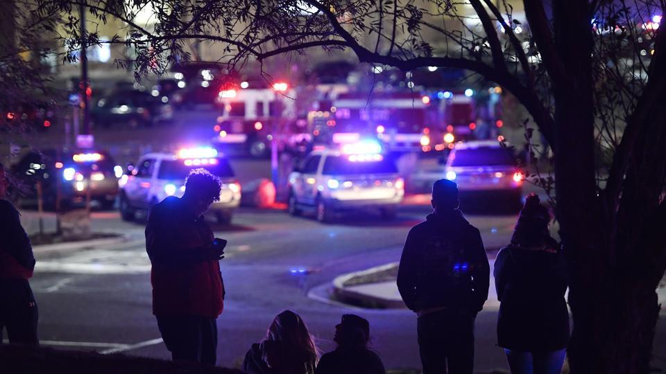 People watch police activity at the scene of a shooting inside Walmart, in Thornton Colorado. Thornton police tweeted Wednesday night that they were responding to a shooting with 'multiple parties down.' They advised people to stay away from the area as dozens of police cruisers and emergency vehicles raced to the scene. (Helen H. Richardson / The Denver Post via AP)