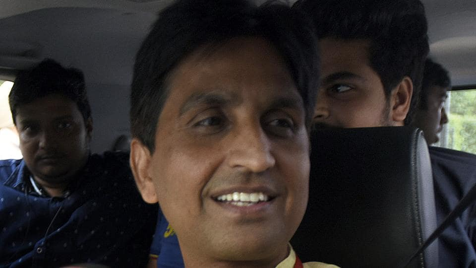 AAP leader Kumar Vishwas talks to media persons after attending the AAP National Council Meeting in New Delhi on Thursday.