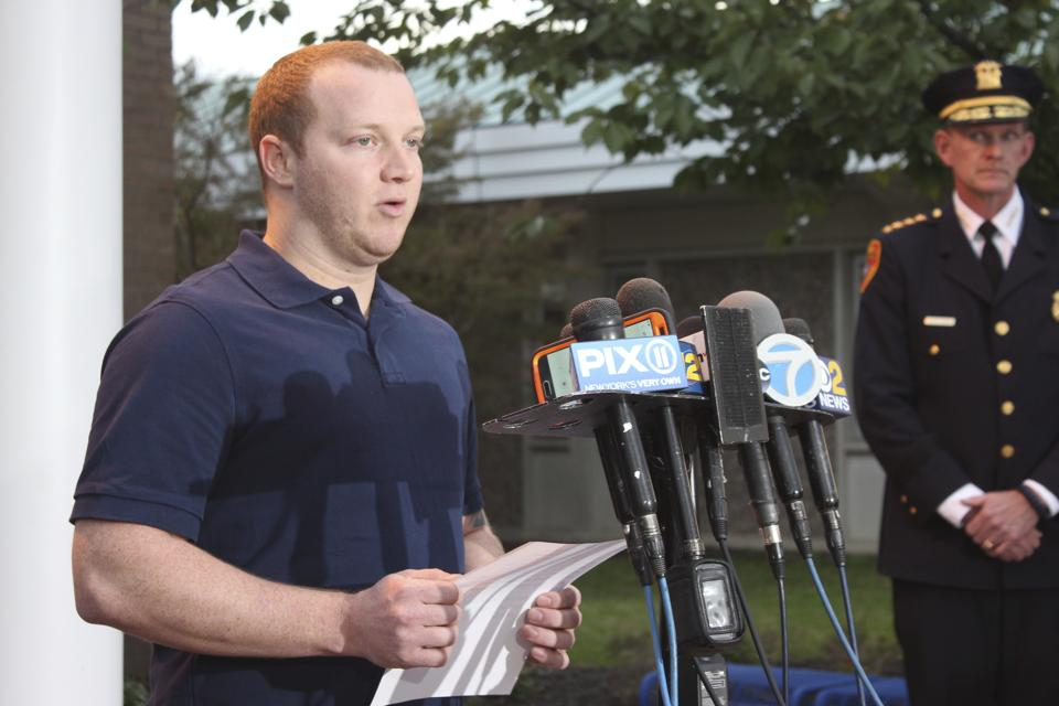 New York City police officer Ryan Nash speaks to reporters at the Suffolk County Police Department's Fifth Precinct in Patchogue.