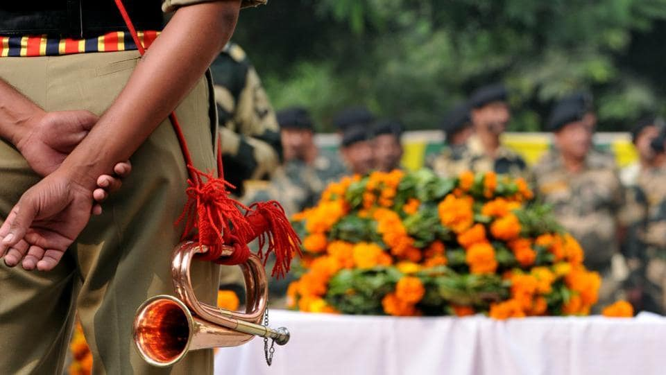 Border security force soldiers paying homage during a wreath-laying ceremony in Jammu on Friday.